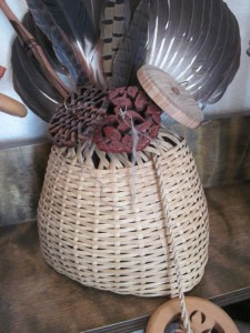 A garlic basket I handmade is displayed with some of my other special spindles