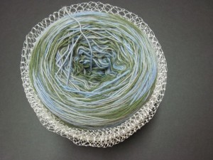 Corral fine lace weight yarn in an elastic-like mesh cradle