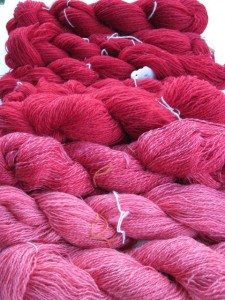 Shades of red in hand spun Romney wool