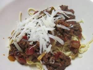 Fresh spaghetti with homemade meat sauce and freshly grated parmesan