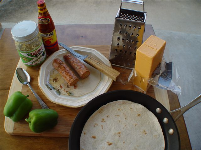 Ingredients and cooking tools for Jackie-O-Lantern Tortilla Pizza Pie