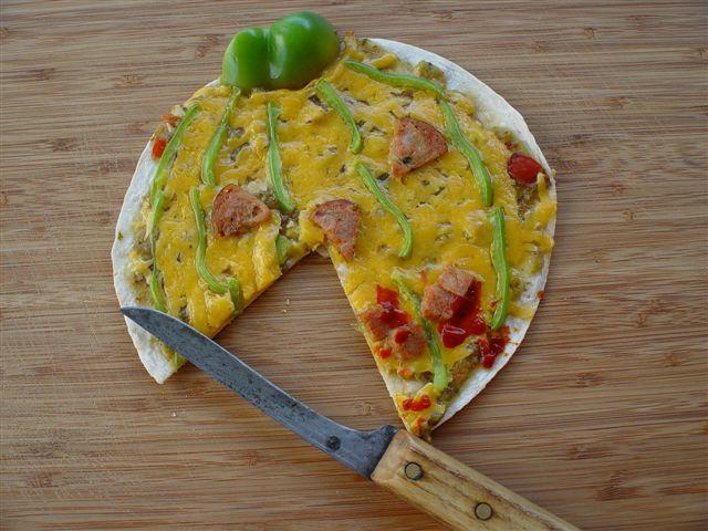 Slice a piece of Jackie-O-Lantern Tortilla Pizza Pie